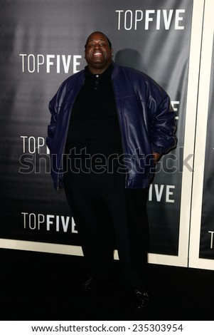 """NEW YORK-DEC 3: Comedian Bruce Bruce attends the """"Top Five"""" premiere at the Ziegfeld Theatre on December 3, 2014 in New York City. - stock photo"""