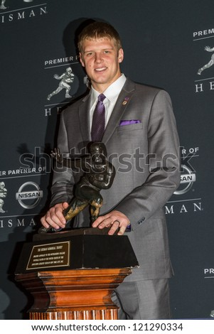 NEW YORK - DEC 8:  Heisman Trophy finalist Colin Klein poses with the Heisman Trophy at the 2012 Heisman Trophy press conference at Marriott Marquis in New York City on December 8, 2012. - stock photo