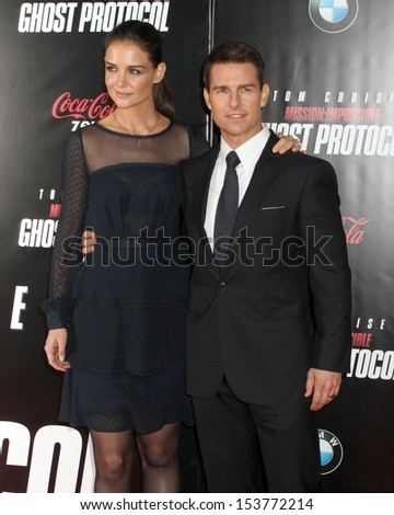 """NEW YORK - DEC 19:  Katie Holmes and Tom Cruise attend the premiere of """"Mission: Impossible - Ghost Protocol"""" at the Ziegfeld Theatre on December 19, 2011 in New York City. - stock photo"""