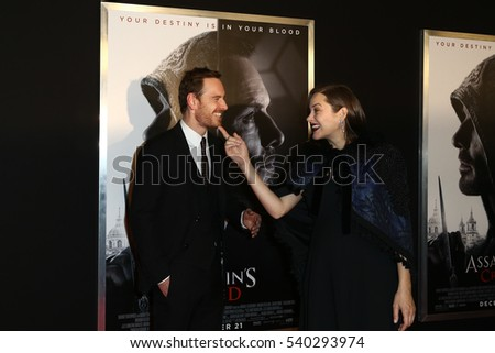 "NEW YORK-DEC 13: Michael Fassbender (L) and Marion Cotillard attend the screening of ""Assassin's Creed"" at AMC Empire on December 13, 2016 in New York City."