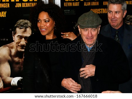 "NEW YORK-DEC 16: Model Grace Hightower and Robert DeNiro (R) attend the world premiere of ""Grudge Match"" at the Ziegfeld Theatre on December 16, 2013 in New York City."