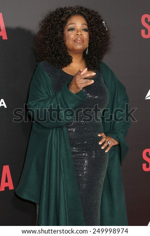 "NEW YORK - DEC 14, 2014: Oprah Winfrey attends the premiere of ""Selma"" at the Ziegfeld Theatre on December 14, 2014 in New York City."