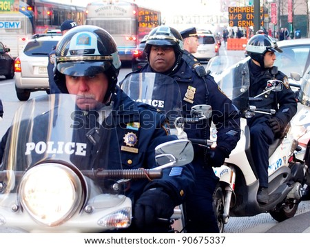 NEW YORK - DEC 12: Police on scooters monitor an Occupy Wall Street protest march on December 12, 2011 in New York City, NY.  Later several demonstrators were arrested after refusing to leave a building. - stock photo