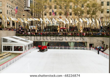 NEW YORK - DEC 25 : Rockefeller Christmas tree and iceskating rink pictured on December 25, 2010 in New York. Built by the Rockefeller family in 1939, it was declared a National Landmark in 1987. - stock photo