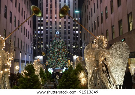 NEW YORK - DEC 19 : Rockefeller Christmas tree and iceskating rink pictured on December 19, 2011 in New York. Built by the Rockefeller family in 1939, it was declared a National Landmark in 1987. - stock photo