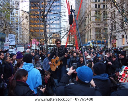 NEW YORK - DEC 1: Stephan Jenkins of the band Third Eye Blind performs in Zuccotti Park, on December 1, 2011 in New York City. The concert was in support of the Occupy Wall Street protest. - stock photo
