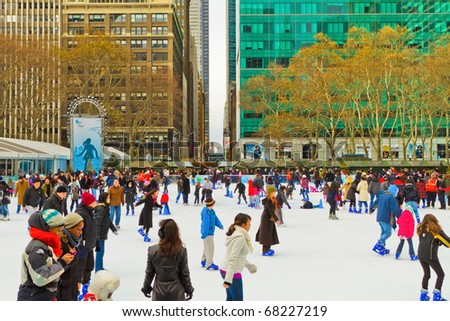 NEW YORK - DEC 25 : The famous annual Christmas market take place in Bryant Park under the skyscrapers, people enjoy the ice skating rink and buy Christmas gifts, on December 25, 2010, in New York. - stock photo