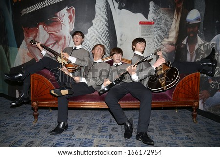 NEW YORK - Dec 6: Wax figures of The Beatles are seen on display at Madame Tussauds on December 6, 2013 in New York City. - stock photo