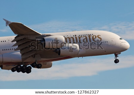 NEW YORK - DECEMBER 9: A A38 Emirates approaches JFK airport in New York, USA on December 9 2012. Airbus A380 is the world's biggest jet airliner and the first to have two full decks