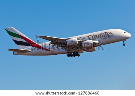 NEW YORK - DECEMBER 9: A A38 Emirates approaches JFK airport in New York, USA on December 9 2012. Airbus A380 is the world's biggest jet airliner and the first to have two full decks - stock photo