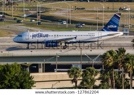 NEW YORK - DECEMBER 9: Airbus A320 JetBlue approaching JFK in New York USA on December 9, 2012 The A320 was the first narrow body airliner from Airbus It is the biggest competition to Boeing 737NG - stock photo