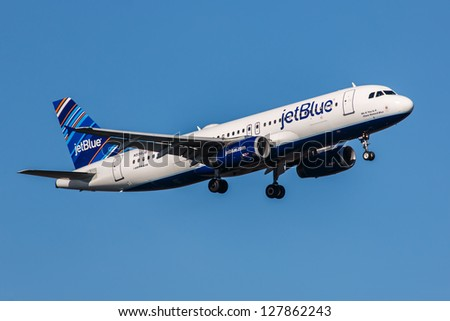 NEW YORK - DECEMBER 9: Airbus A320 JetBlue approaching JFK in New York USA on December 9, 2012 The A320 was the first narrow body airliner from Airbus It is the biggest competition to Boeing 737NG