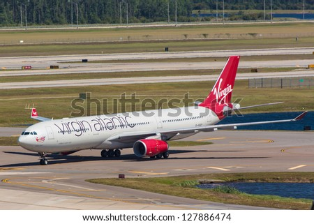 NEW YORK - DECEMBER 9: Airbus 330 Virgin Atlantic taxiing on JFK in New York USA on December 9 2012 Virgin Atlantic is British airline owned by Richard Branson's Virgin Group and Singapore Airlines - stock photo