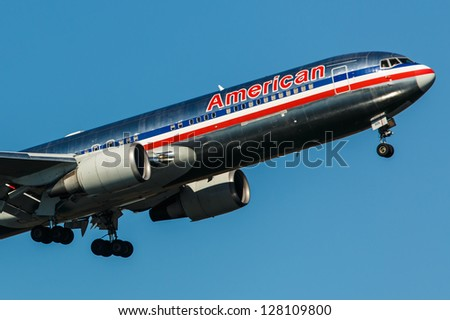 NEW YORK - DECEMBER 6: Boeing 767 American Airlines climb after take off from JFK in New York USA on December 6 2012. 767 flies across the Atlantic more frequently than all other jetliners combined - stock photo