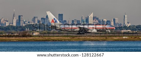 NEW YORK - DECEMBER 9: Boeing 767 American Airlines lining up on JFK runway in New York USA on December 9 2012 The 767 flies across the Atlantic more frequently than all other jetliners combined