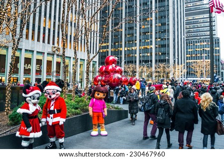 NEW YORK-DECEMBER 30: Characters in costume, tourists and holiday decorations near Rockefeller Center on December 30, 2013 in Manhattan. - stock photo
