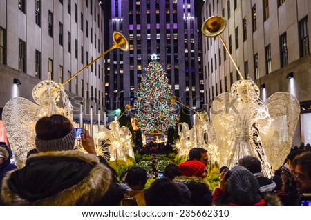 NEW YORK-DECEMBER 4: Crowds of tourists visit Rockefeller Center to see the tree and holiday decorations on December 4, 2014 in Manhattan. - stock photo
