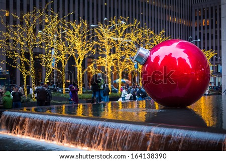 NEW YORK - DECEMBER 25: Giant Christmas ornament at 1251 Sixth Avenue on December 25, 2012 in New York. - stock photo