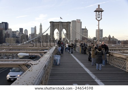 NEW YORK - DECEMBER 12:  Horizontal wide angle view of the Brooklyn Bridge with tourists and regular pedestrians December 12th, 2007 in New York City.