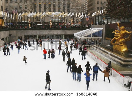NEW YORK - DECEMBER 19: Lower Plaza of Rockefeller Center with ice-skating rink and Christmas tree in Midtown Manhattan on December 19, 2013. Ice-skating began since Christmas Day in 1936  - stock photo
