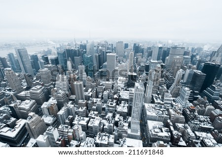 NEW YORK - DECEMBER 3, 2013: New York City Manhattan midtown aerial panorama view with skyscrapers in cold winter day - stock photo