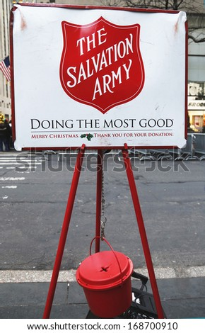 NEW YORK - DECEMBER 19  Salvation Army red kettle for collections on December 19, 2013 in midtown Manhattan  This Christian organization is known for its charity work, operating in 126 countries  - stock photo