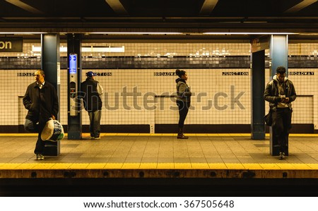 NEW YORK - December 21, 2015: Subway train Broadway station platform with people traveling in New York. The NYC Subway is a rapid transit/transportation system in the City of NY. - stock photo
