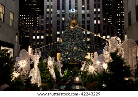 NEW YORK - DECEMBER 4:   The crowds flock to see the lit tree and other decorations at Rockefeller Center on the evening of December 4, at New York City, NY. - stock photo