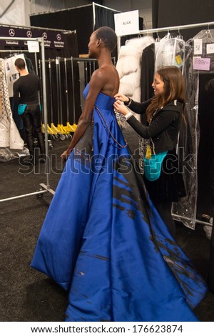 NEW YORK-FEB 10: Model Ajak Deng gets ready backstage at the Dennis Basso fashion show during Mercedes-Benz Fashion Week Fall 2014 at Lincoln Center on February 10, 2014 in New York City.