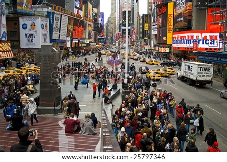 NEW YORK - FEB 27: Pedestrians gather in Times Square on February 27, 2009 in New York City. New Plans to ban vehicle traffic on Broadway from 42nd to 47th Streets are scheduled to begin this May.