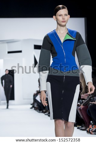 NEW YORK - FEBRUARY 09: A model is walking the runaway at Lacoste Ready to Wear Fall/Winter 2013-2014 fashion show during Mercedes-Benz Fashion Week on February 09, 2013 in New York - stock photo