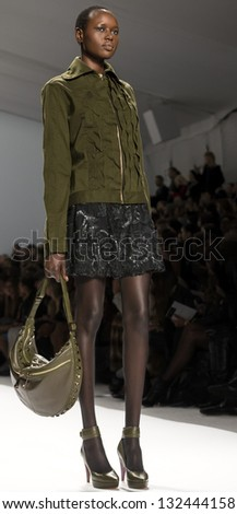 NEW YORK - FEBRUARY 13: A model is walking the runaway at Nanette Lepore Show for Fall/Winter 2013 Collection during Mercedes-Benz Fashion Week on February 13, 2013 in New York - stock photo