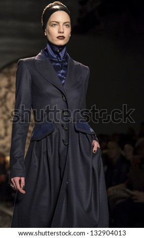 NEW YORK - FEBRUARY 11: A model is walking the runaway at Pamella Roland Show for Fall/Winter 2013 Collection during Mercedes-Benz Fashion Week on February 11, 2013 in New York