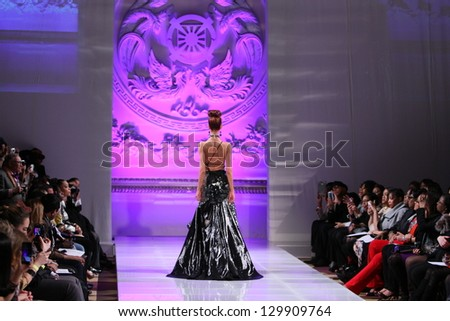 NEW YORK - FEBRUARY 17:  A Model walks on the Lourdes Atencio fashion runway at The New Yorker Hotel during Couture Fashion Week on February 17, 2013 in New York City - stock photo