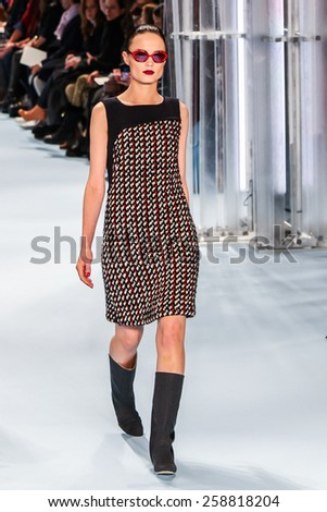 NEW YORK - FEBRUARY 16: A model walks the runway at the Carolina Herrera Fall/Winter 2015 collection during Mercedes-Benz Fashion Week in New York on February 16, 2015. - stock photo