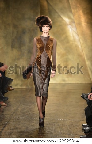 NEW YORK - FEBRUARY 11: A model walks the runway at the Donna Karan Fall Winter 2013 Collection during Mercedes-Benz Fashion Week on February 11, 2013 in New York City. - stock photo