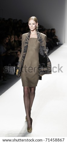 NEW YORK - FEBRUARY 17: A model walks the runway at the Elene Cassis Fall 2011 fashion show during Mercedes-Benz Fashion Week at The Studio at Lincoln Center on February 17, 2011 in New York City.