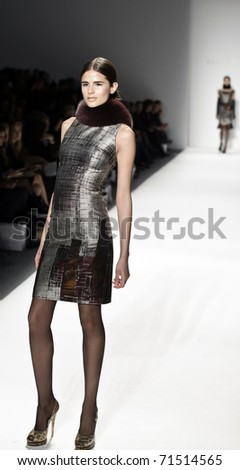 NEW YORK - FEBRUARY 17: A model walks the runway at the Elene Cassis Fall/Winter 2011 fashion show during Mercedes-Benz Fashion Week at The Studio at Lincoln Center on February 17, 2011 in NYC. - stock photo