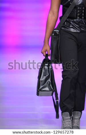 NEW YORK - FEBRUARY 15: A model walks the runway at the Marisol Henriquez Fall Winter 2013 fashion show during Couture Fashion Week on February 15, 2013 in New York City.