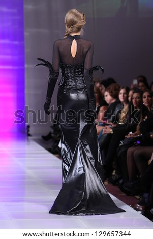 NEW YORK - FEBRUARY 15: A model walks the runway at the Marisol Henriquez Fall Winter 2013 fashion show during Couture Fashion Week on February 15, 2013 in New York City. - stock photo