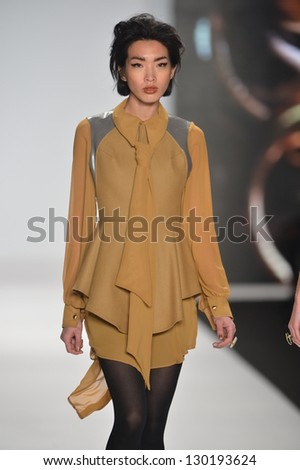 NEW YORK - FEBRUARY 08: A model walks the runway at the Project Runway Fall Winter 2013 fashion show during Mercedes-Benz Fashion Week on February 8, 2013 in New York City. - stock photo