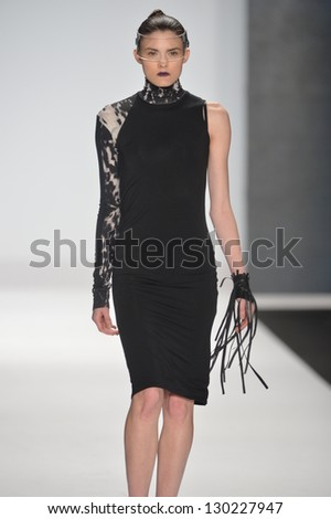 NEW YORK - FEBRUARY 08: A model walks the runway at the Project Runway Fall Winter 2013 fashion show during Mercedes-Benz Fashion Week on February 8, 2013 in New York City.