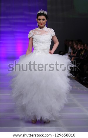 NEW YORK - FEBRUARY 15: A model walks the runway at the Ruby Johns Fall Winter 2013 fashion show during Couture Fashion Week on February 15, 2013 in New York City.