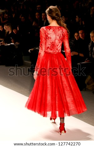 NEW YORK - FEBRUARY 07:A model walks the runway at the  Tadashi Shoji  Fall 2013 collection Mercedes-Benz Fashion Week in New York on February 07,2013 - stock photo