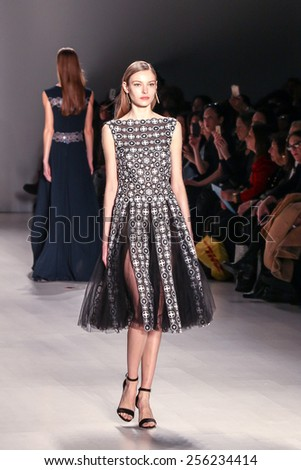 NEW YORK - FEBRUARY 12: A model walks the runway at the Tadashi Shoji Fall/Winter 2015 collection during Mercedes-Benz Fashion Week in New York on February 12, 2015. - stock photo