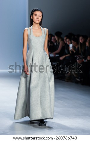 NEW YORK - FEBRUARY 16: A model walks the runway at the Taoray Wang Fall/Winter 2015 collection during Mercedes-Benz Fashion Week in New York on February 16, 2015.