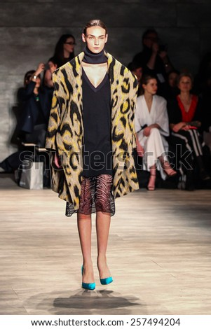 NEW YORK - FEBRUARY 12: A model walks the runway at the Tome Fall/Winter 2015 collection during Mercedes-Benz Fashion Week in New York on February 12, 2015. - stock photo