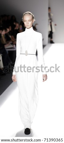 NEW YORK - FEBRUARY 16: A model walks the runway at the Yigal Azrouel Fall 2011 fashion show during Mercedes-Benz Fashion Week at The Studio at Lincoln Center on February 16, 2011 in NYC. - stock photo