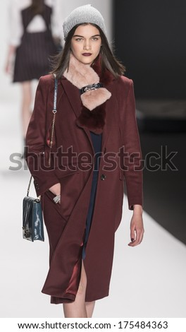 NEW YORK - FEBRUARY 07 2014: A model walks the runway during the Rebecca Minkoff fall 2014 fashion show at New York Mercedes - Benz Fashion Week