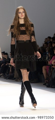 NEW YORK - FEBRUARY 11: A model walks the runway in the Jill Stuart Fall 2012 collection during Mercedes-Benz Fashion Week on February 11, 2012 in New York City. - stock photo